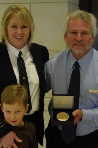 Jennifer, Kenny and Jacob with medal